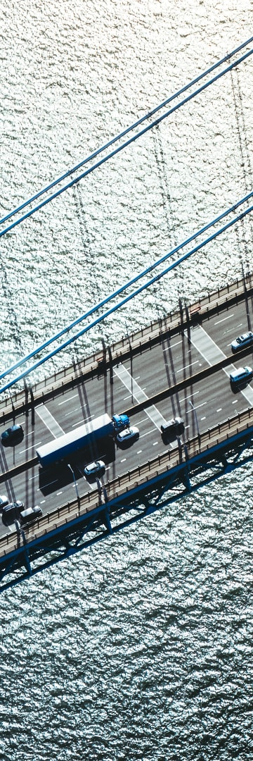 Aerial view of traffic on a bridge over water -- Internal and External Forces