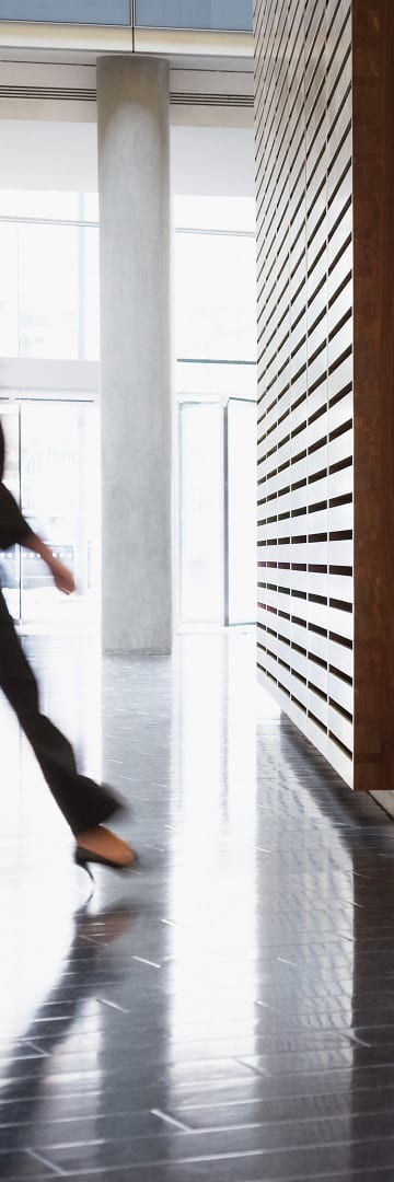 Woman walking in lobby of office building -- Shareholder Proposals