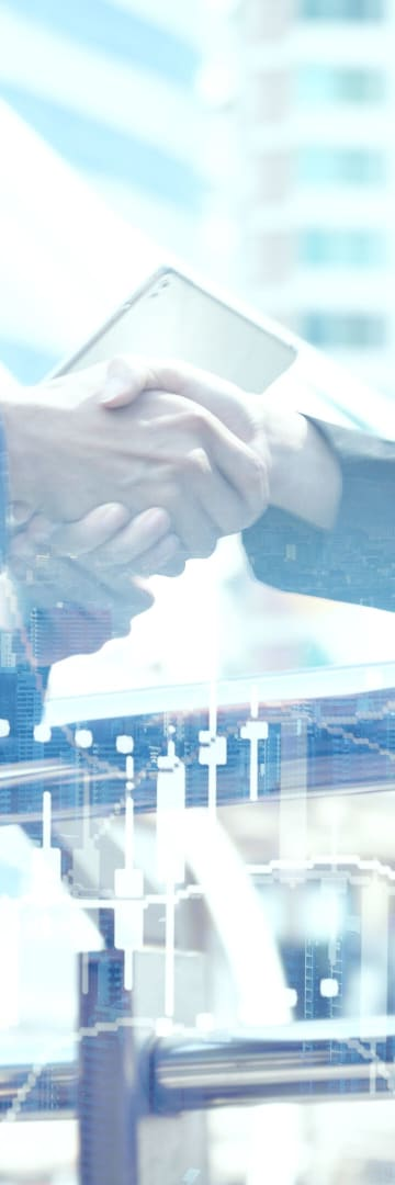 Two people shaking hands, financial transaction, private equity
