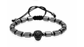 Buy this discounted product Paris Martin Distinctive Adjustable Beaded Bracelet with Black Skull and Hematite Cylinder Beads on Amazon