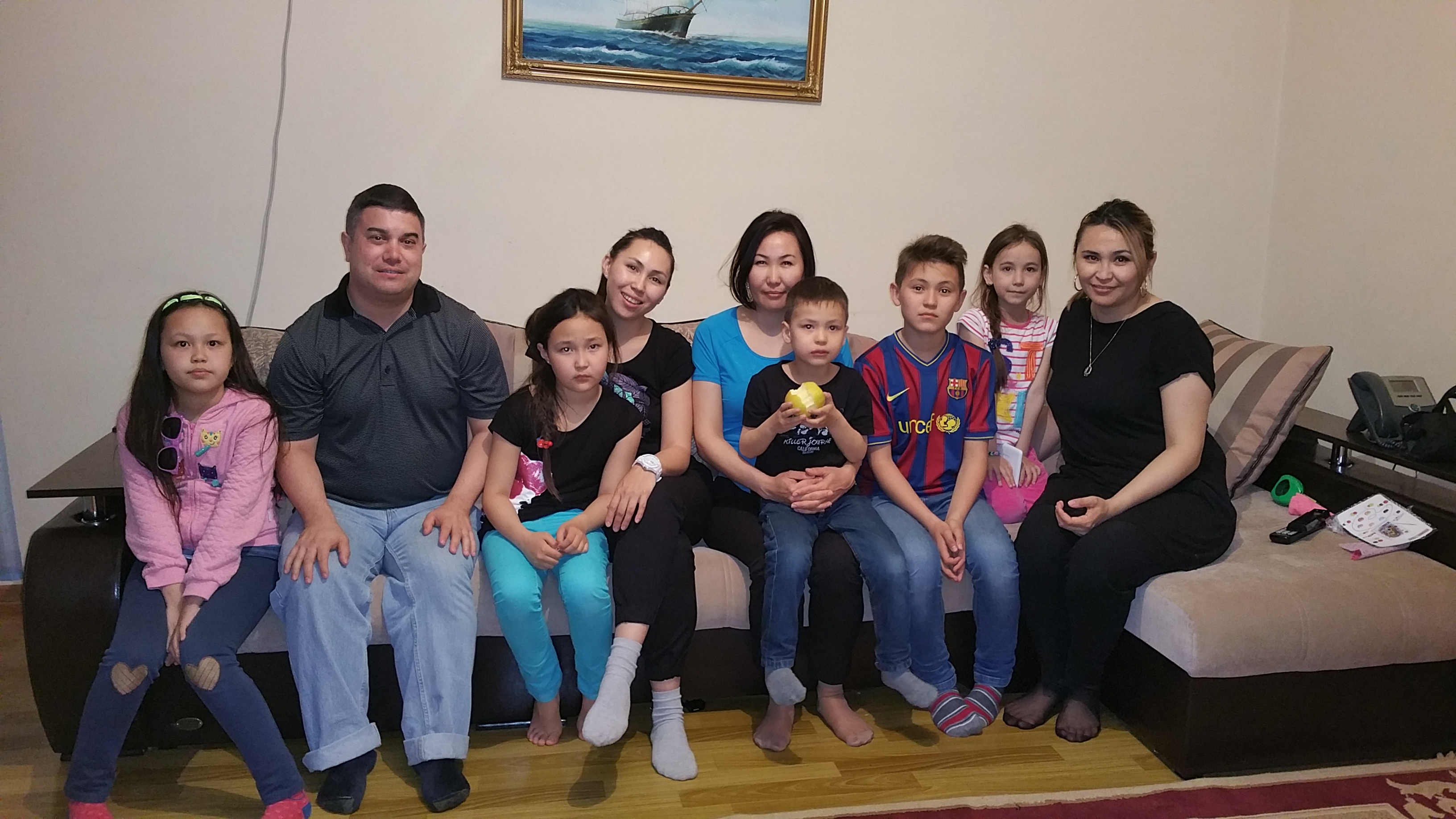 With my Kazakh host sisters and their children in Aktau, Kazakhstan