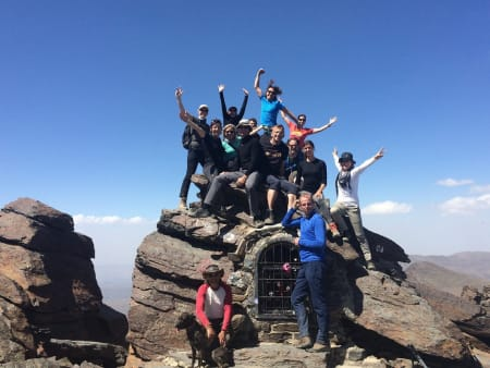 A group successfully completing a summer ascent of the mountain