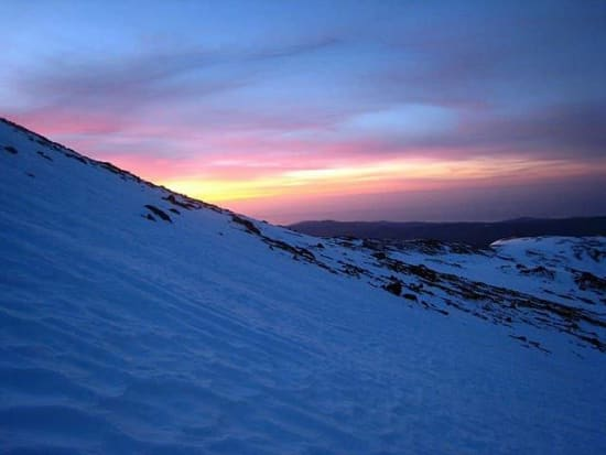Brilliant sunrise following night ascent of Mulhacen, Spain