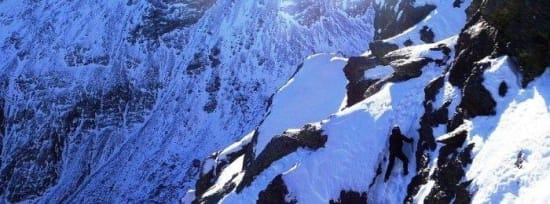 Wading through thigh deep powder snow in the Sierra Nevada