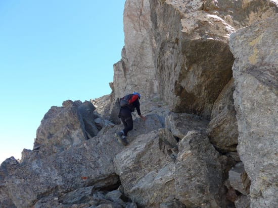 The initial scramble left of the main crag (crux)