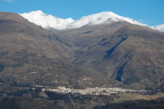 Town of Lanjaron with the Sierra Nevada mountains Rising behind