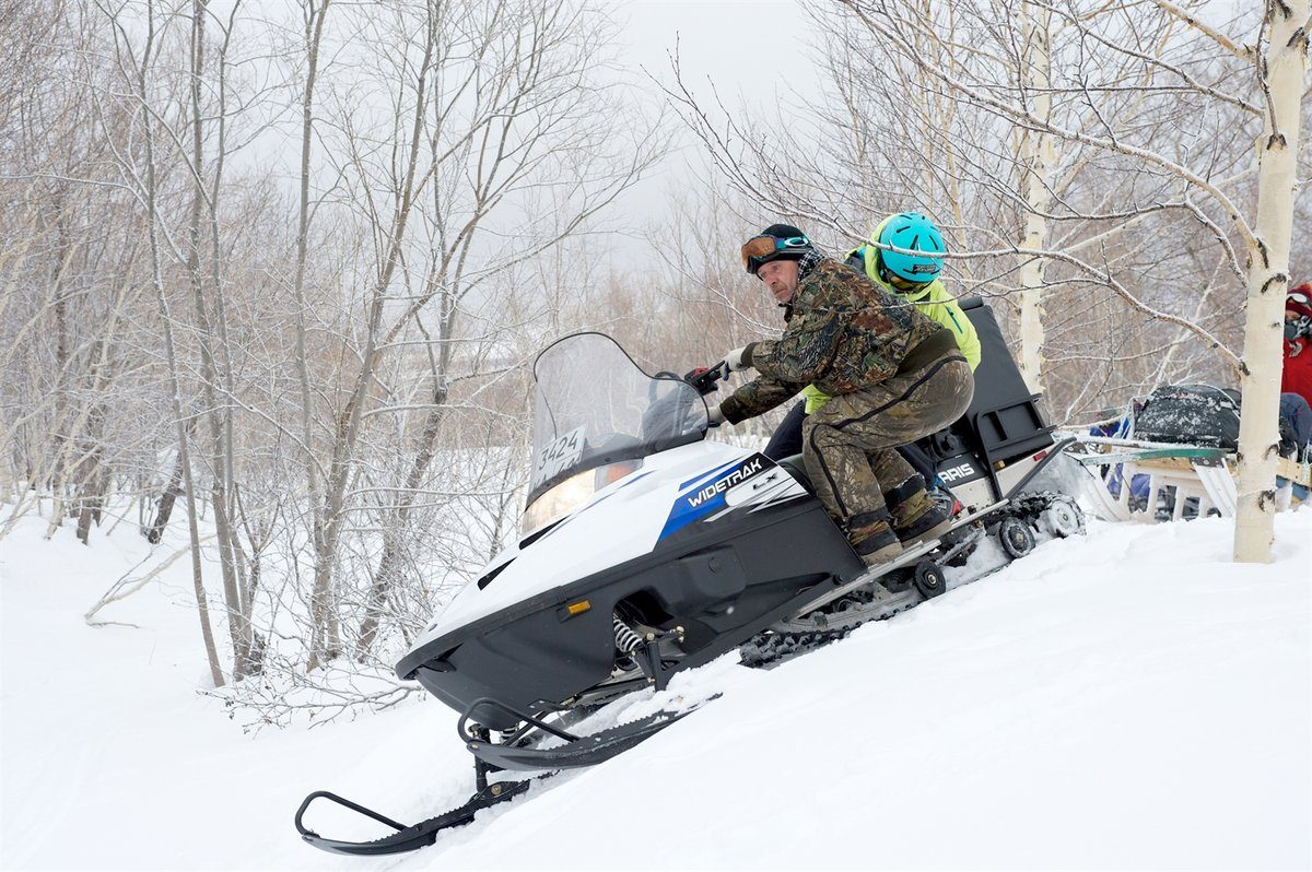 Trying to help balance the snowmobile. Photo courtesy of Martin Hartley