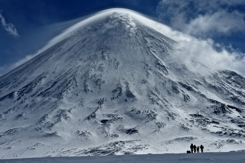 Doesn't seem right walking towards an erupting volcano. Photo courtesy of Martin Hartley