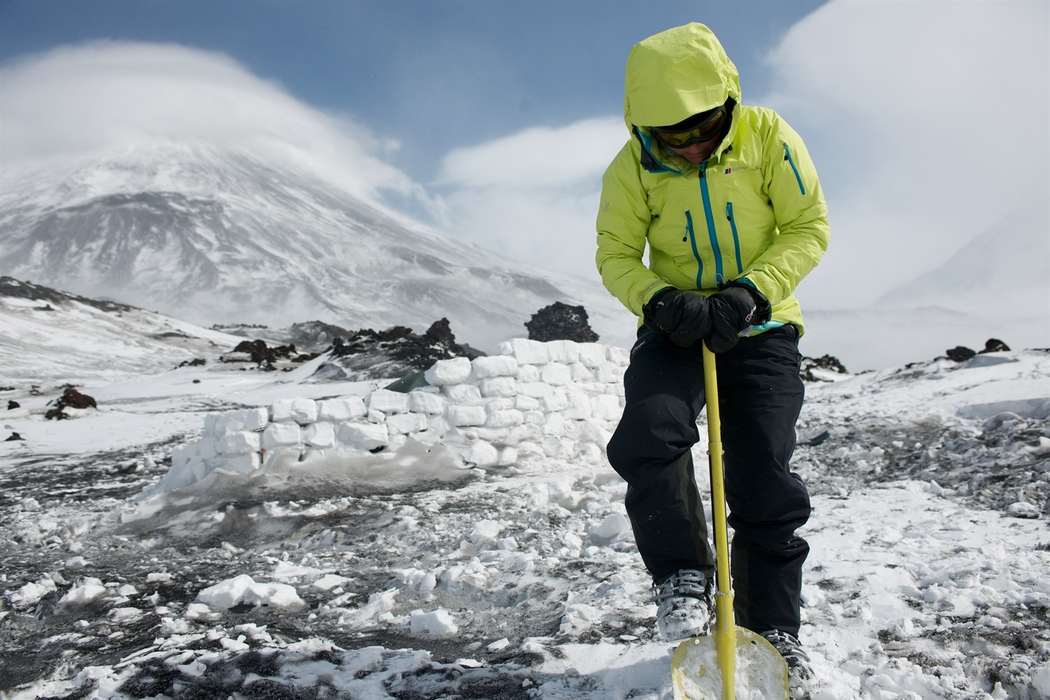 Me digging up snow to re-enforce the snow wall during a break in the weather. Photo courtesy of Martin Hartley