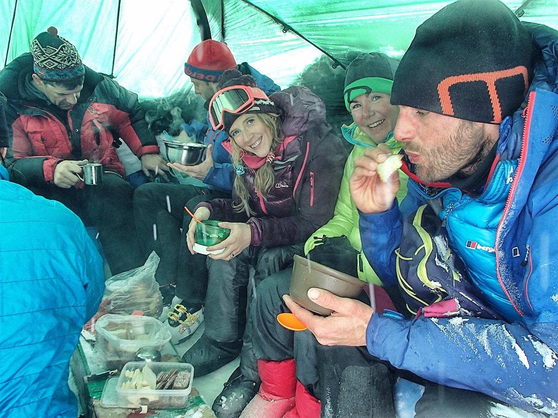 In the kitchen tent having dinner