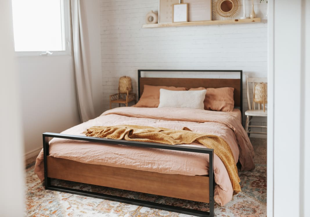 suzanne wood and metal platform bed frame in bedroom setting