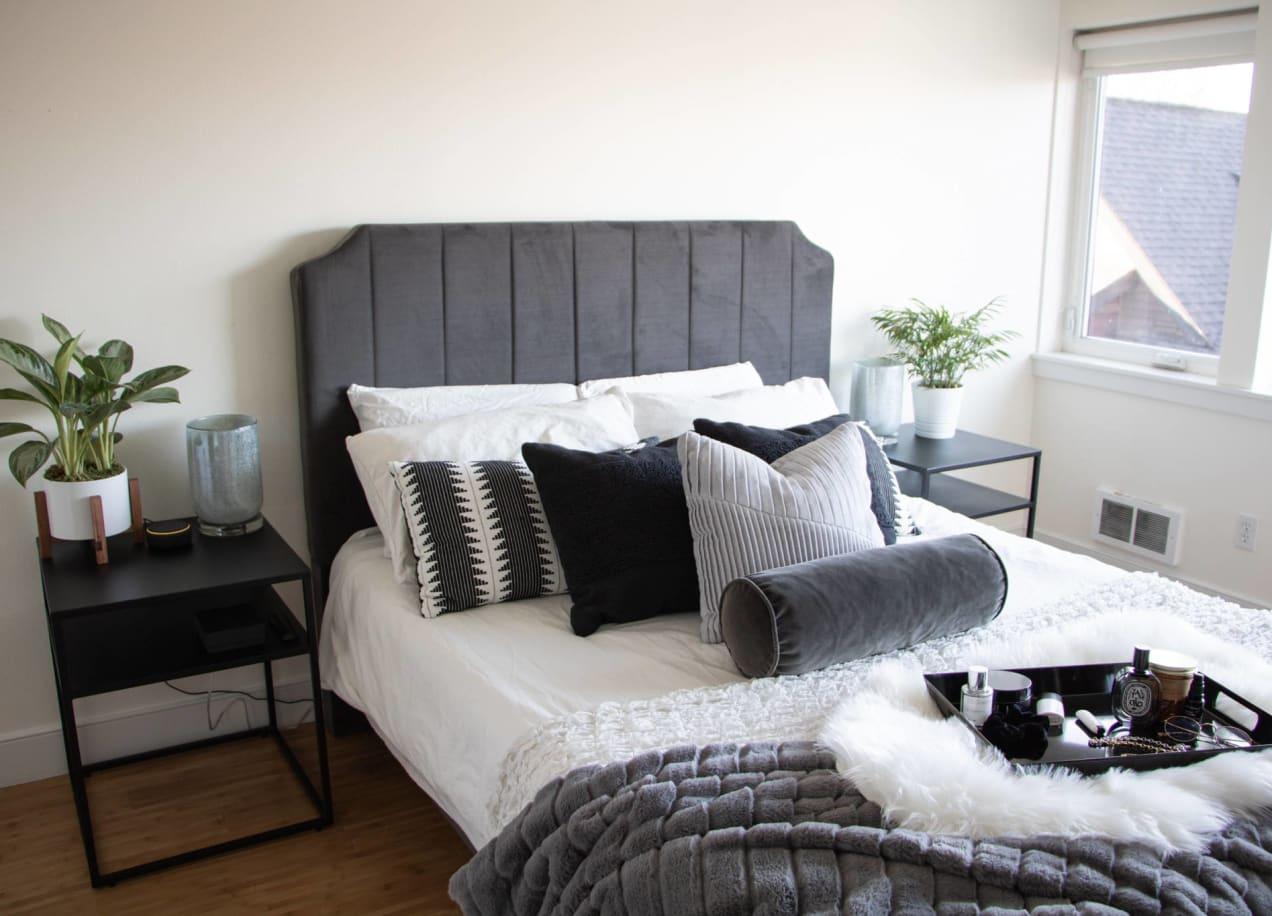 holiday decor in bedroom with velvet headboard