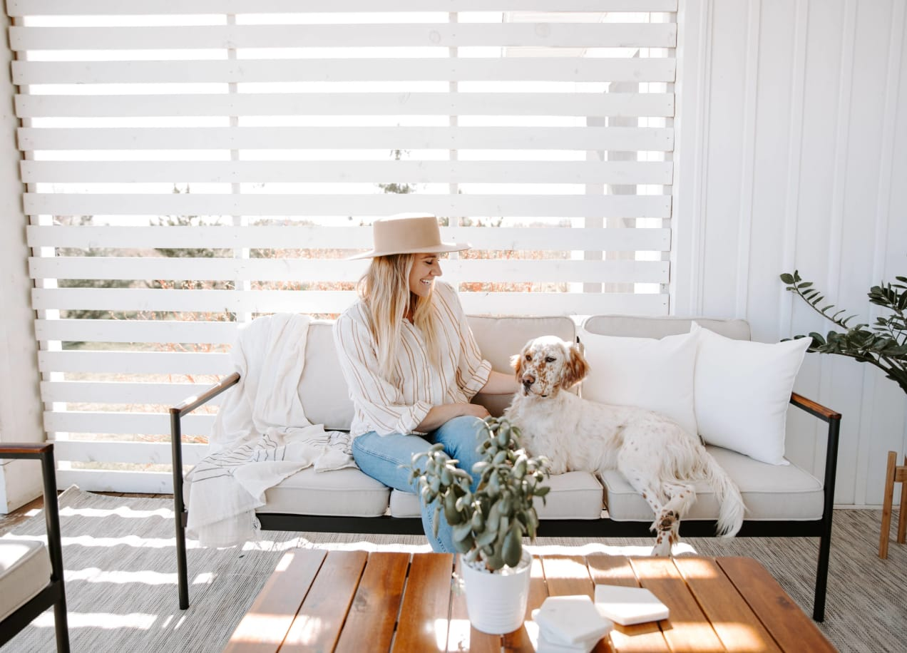 savannah outdoor set with lady and dog