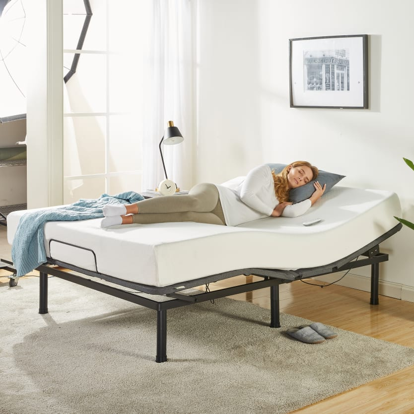 Woman sleeping on an adjustable bed