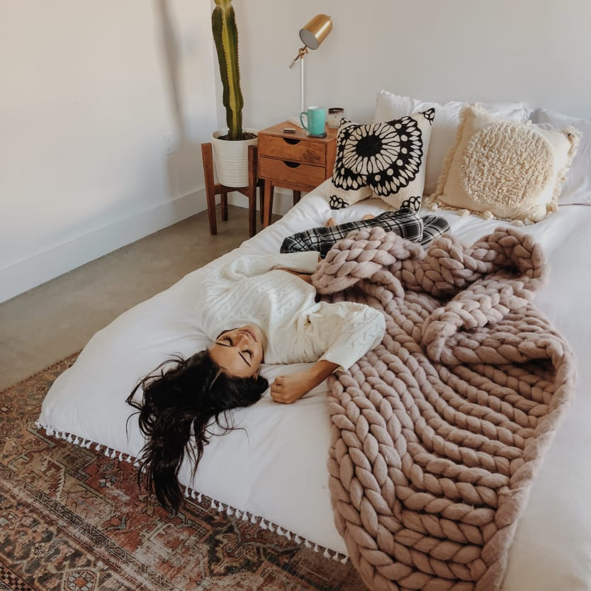 Woman napping on a bed