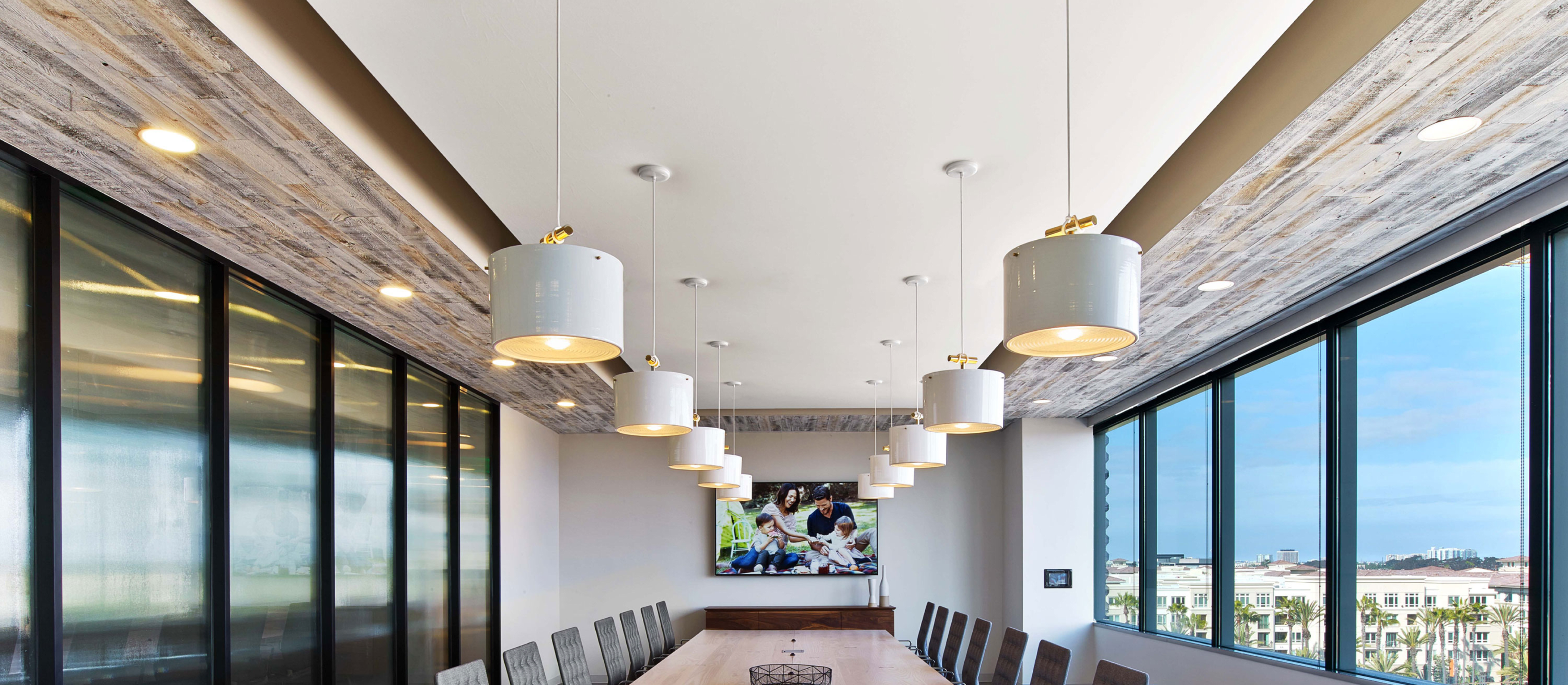 Modern office conference room with Stikwood real reclaimed pine peel and stick wood plank ceiling with silver, gray, tan and brown colors.