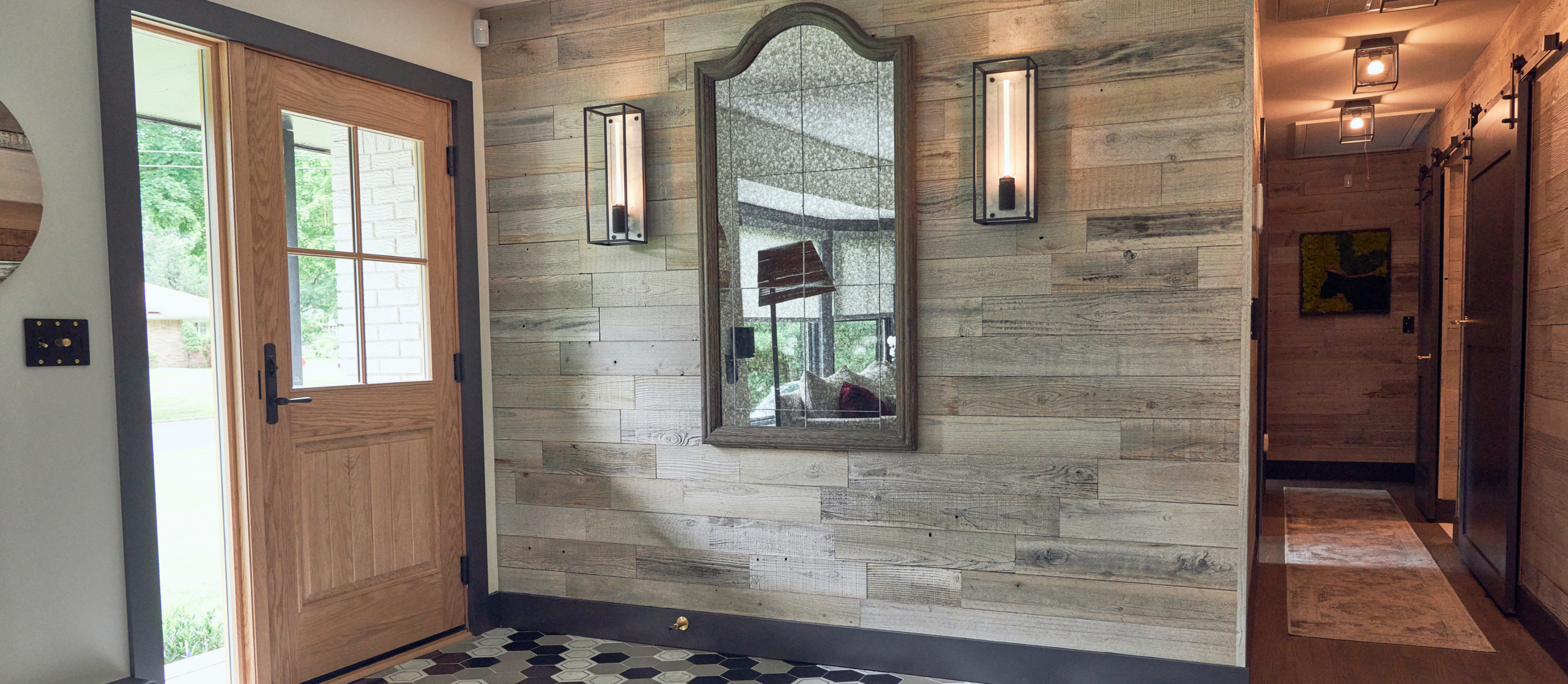 Classic entryway to John Colaneri home with a Stikwood real reclaimed redwood peel and stick wood plank accent wall with light, white, gold, gray, tan, black and brown colors.