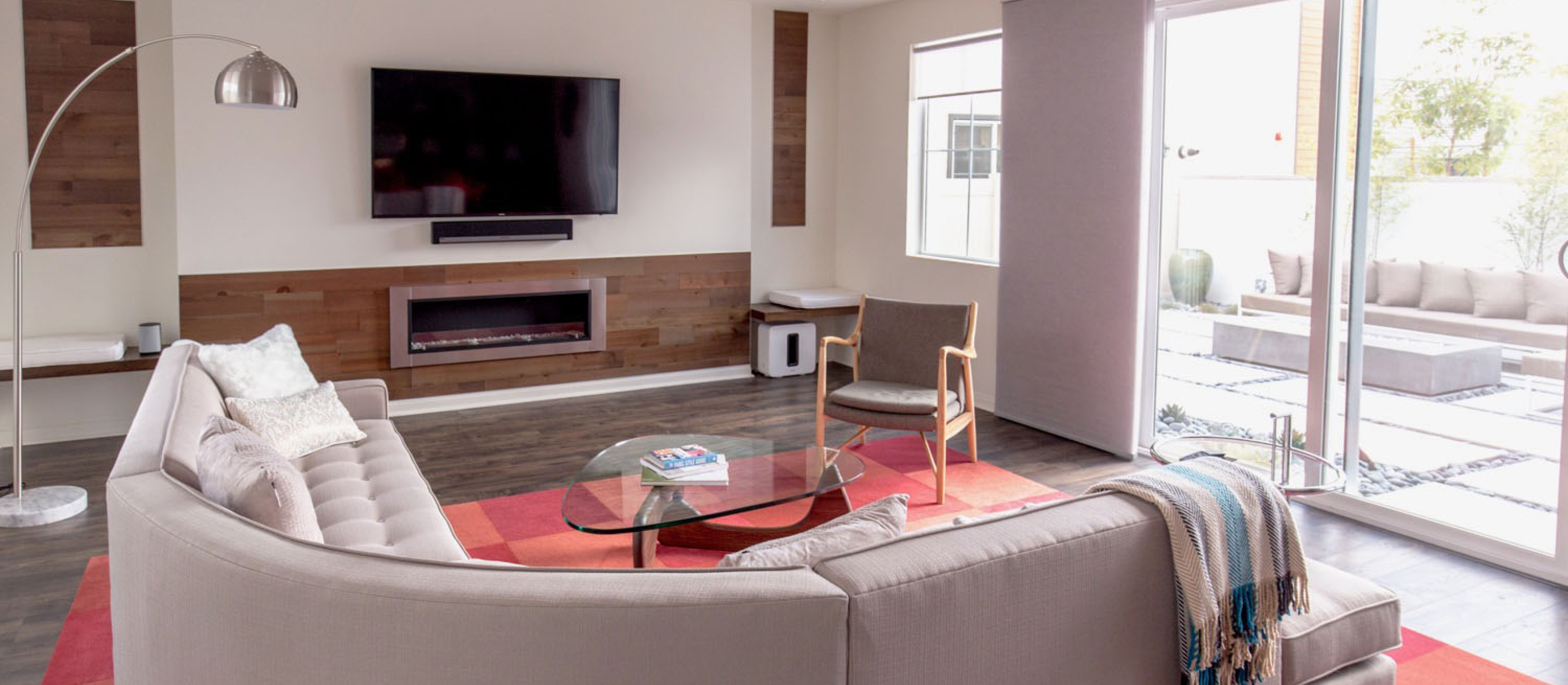 Modern great living room with a Stikwood real reclaimed douglas fir peel and stick wood plank accents with a warm cinnamon-brown color.