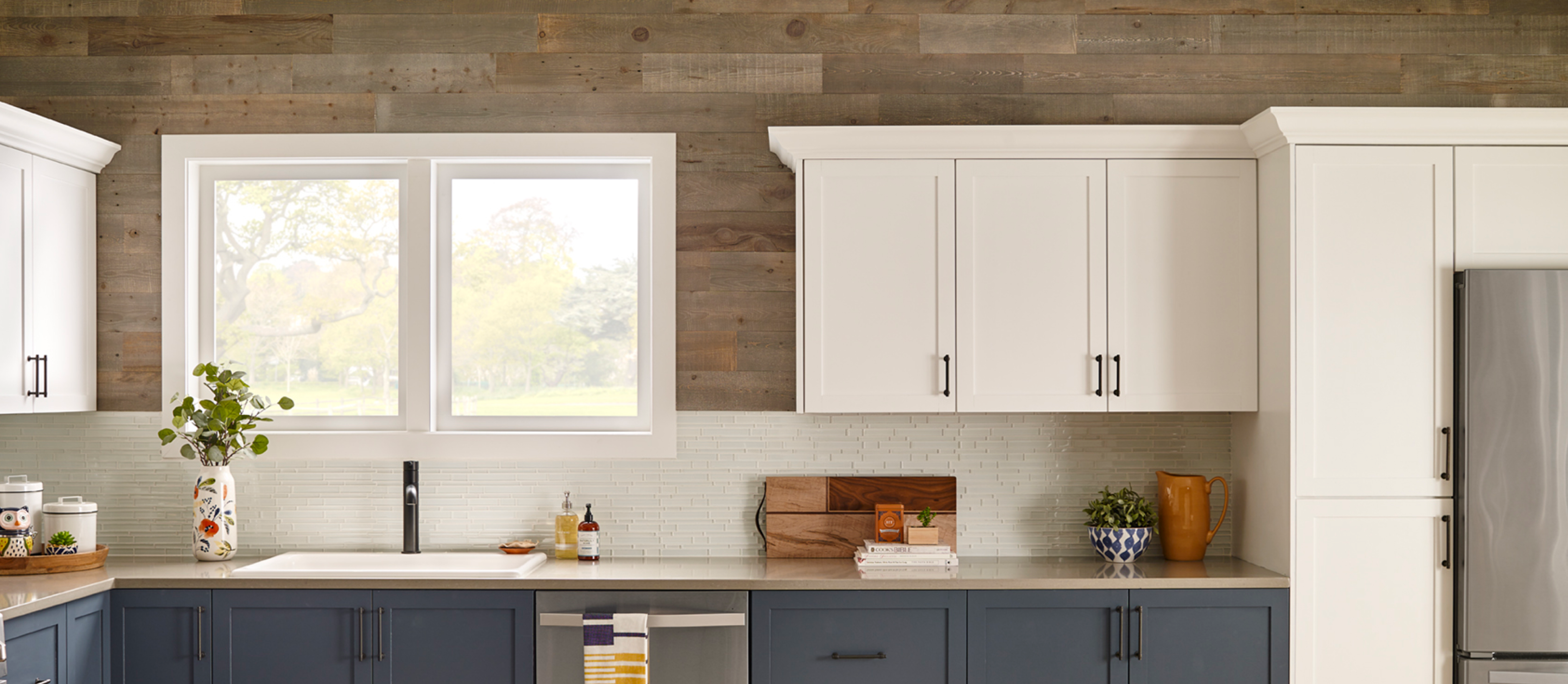 Classic kitchen with white cabinets and a Stikwood real reclaimed pine peel and stick wood plank accent wall with light, gray, tan, brown colors.