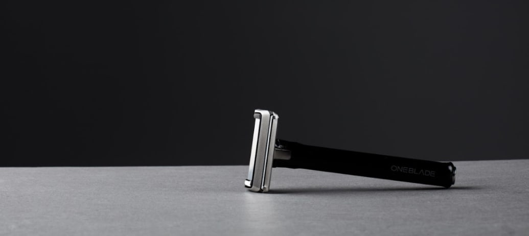 OneBlade razor laying on a counter