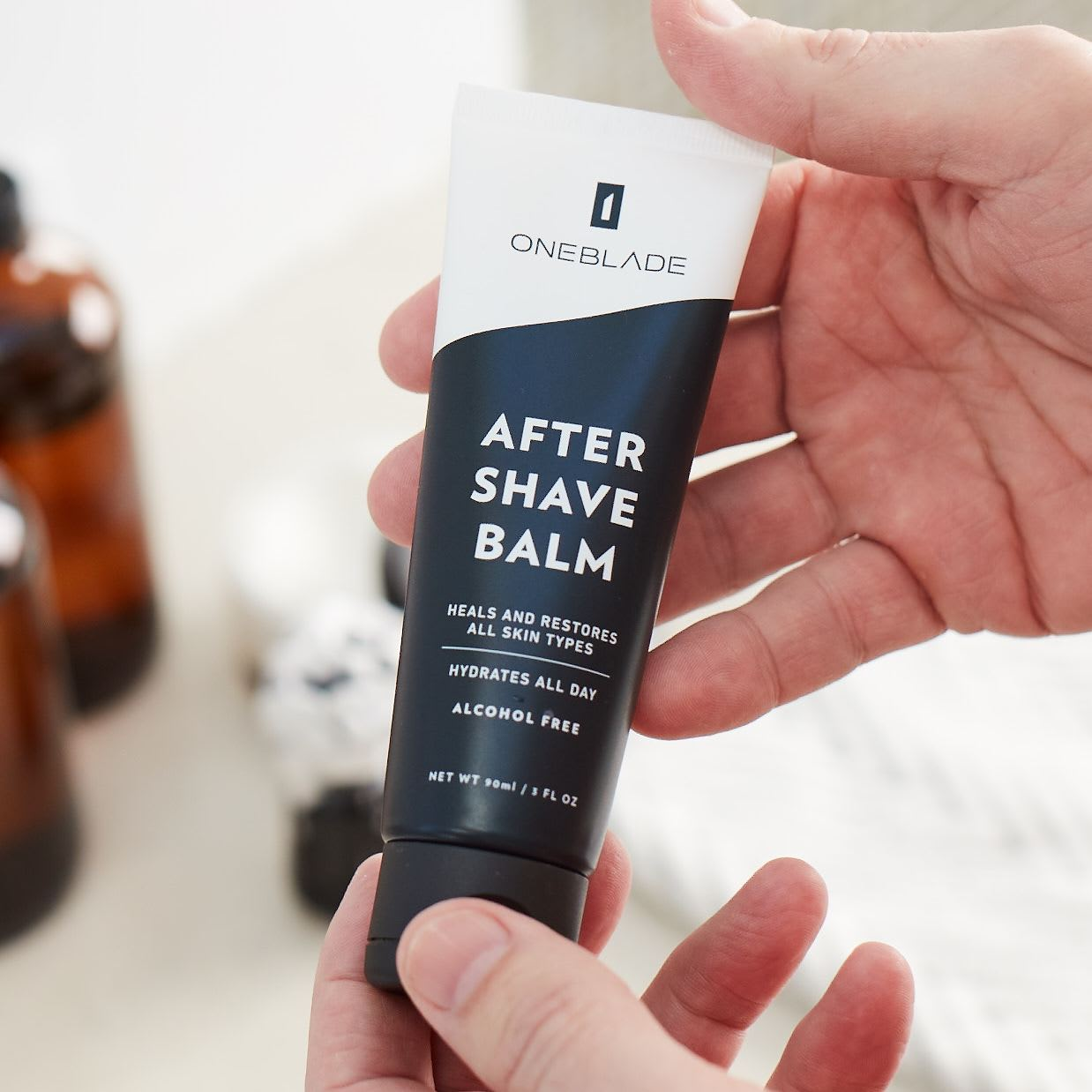 OneBlade after shave balm held by hands