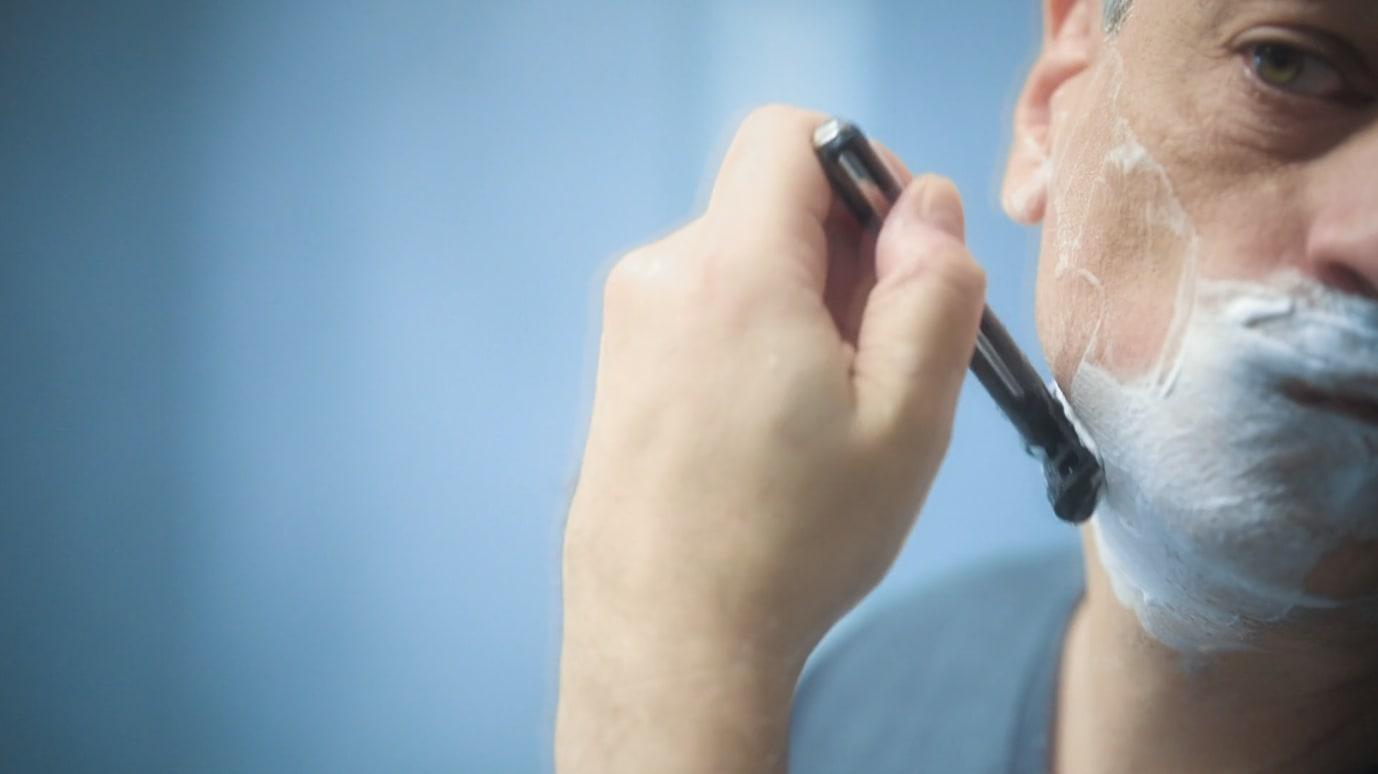 Man using a OneBlade razor to shave