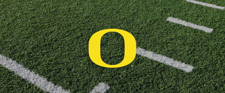 Oregon Collegiate Silicone Rings, Oregon logo on football field