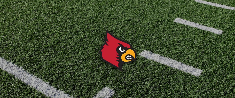 Louisville logo on football field