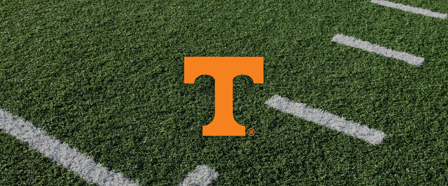 Tennessee Collegiate Silicone Rings, UT overlaid on football field