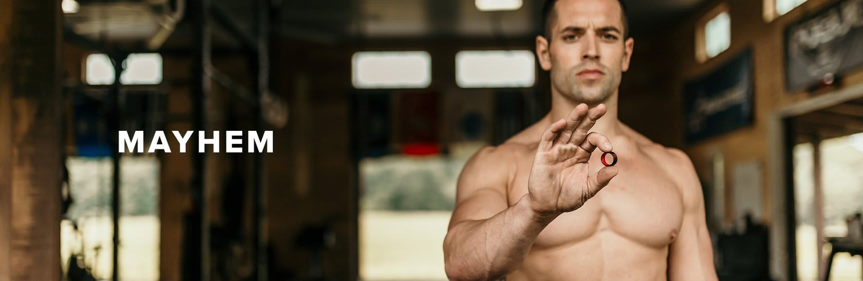 Mayhem, Rich Froning holding up a groove ring in his studio