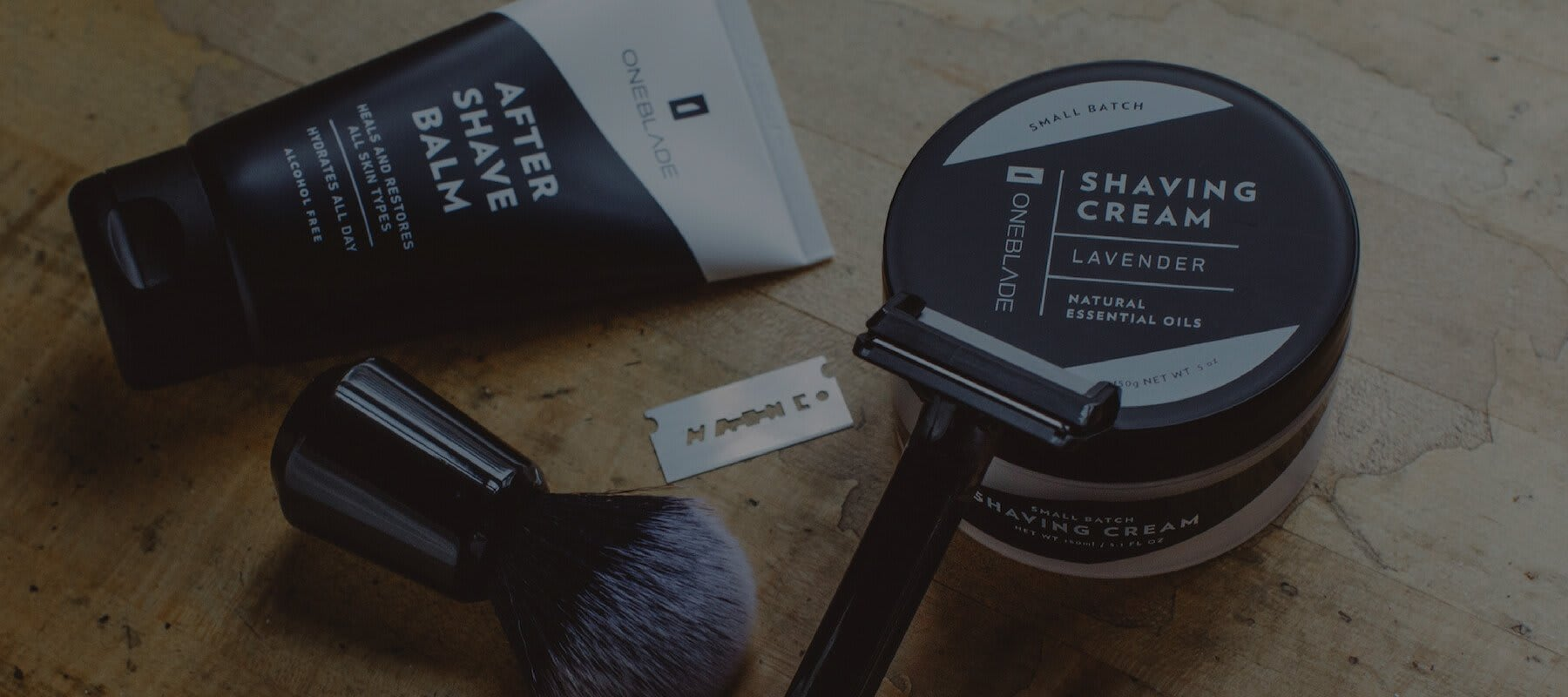 """Oneblade """"Black Tie"""" Shaving kit items, including a razor, blade, brush, """"After Shave Balm"""", and"""