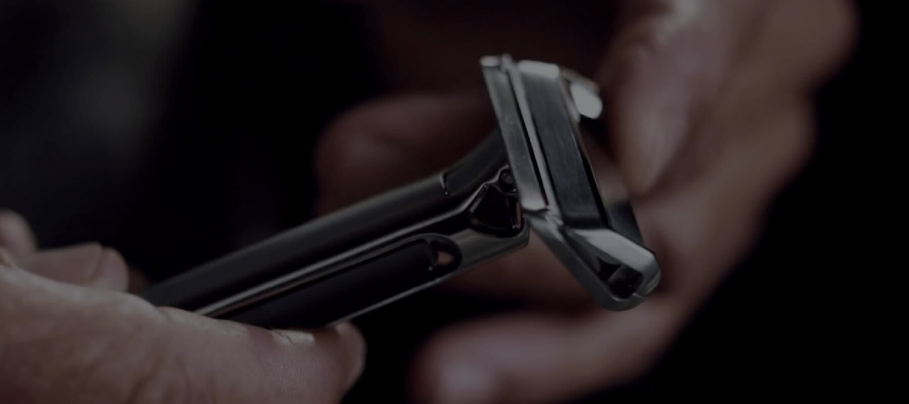 A OneBlade razor being inspected by hand