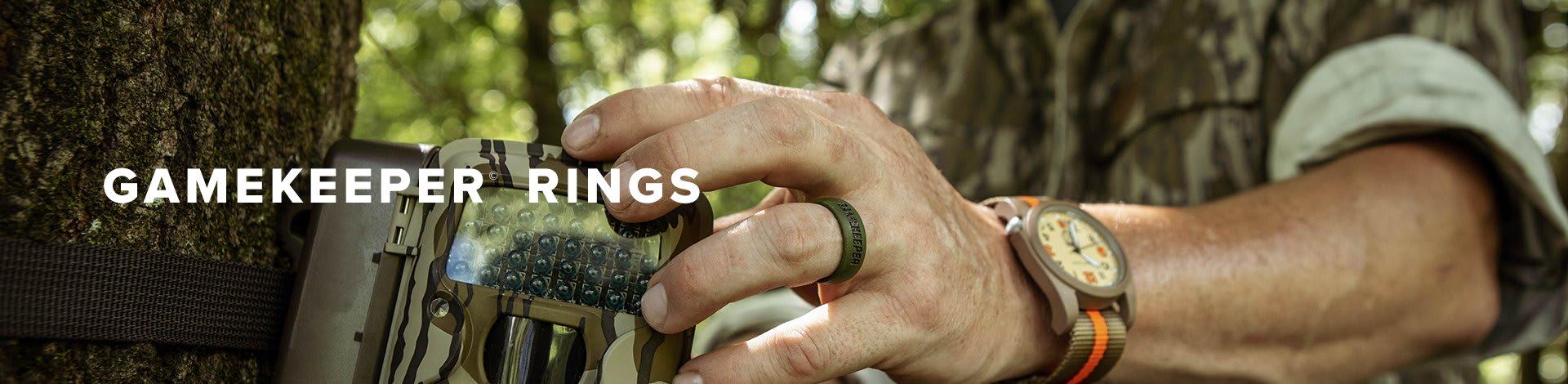 Mossy Oak Gamekeepers rings; man drawing his bow