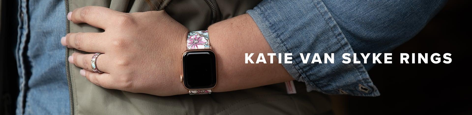 Katie Van Slyke rings, Katie in the background with her hand on her hip