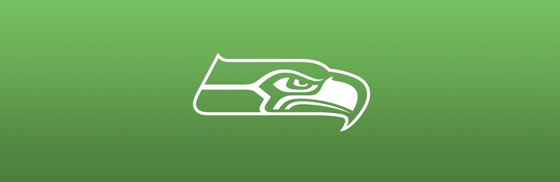 Seattle Seahawks logo overlaid on light green background