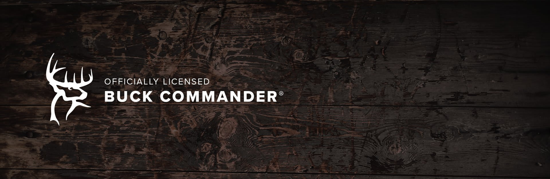 Buck Commander, Buck Commander logo overlaid on wood-like background