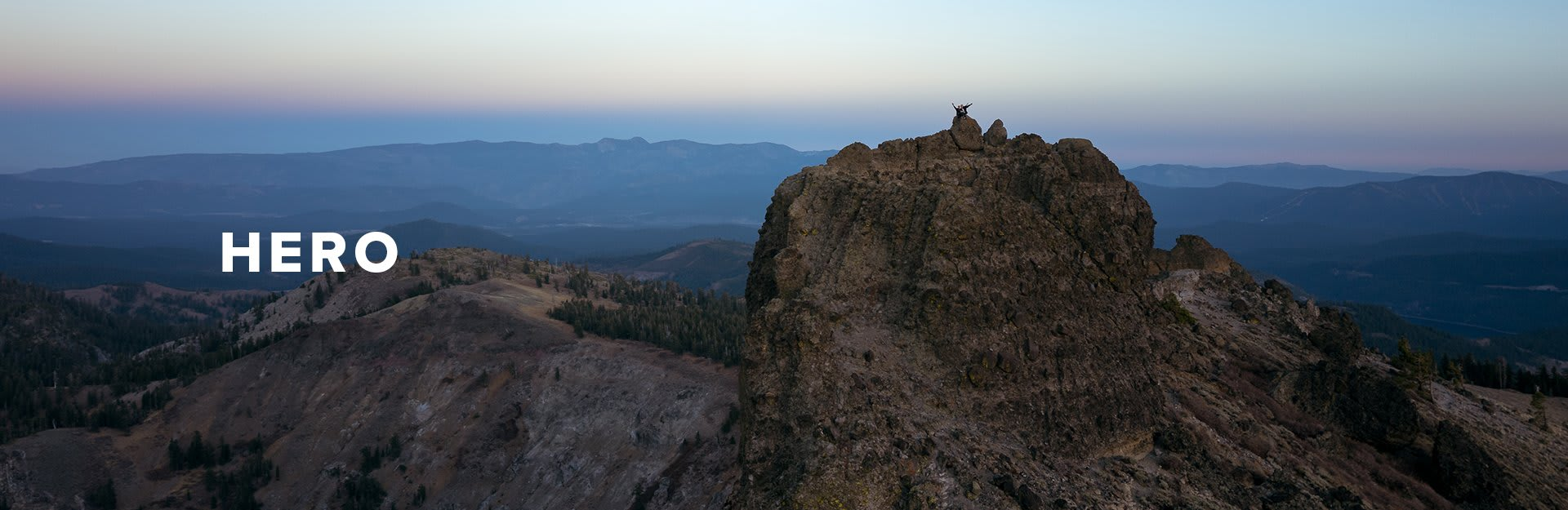 Hero, a landscape of rocky mountains with a blue horizon