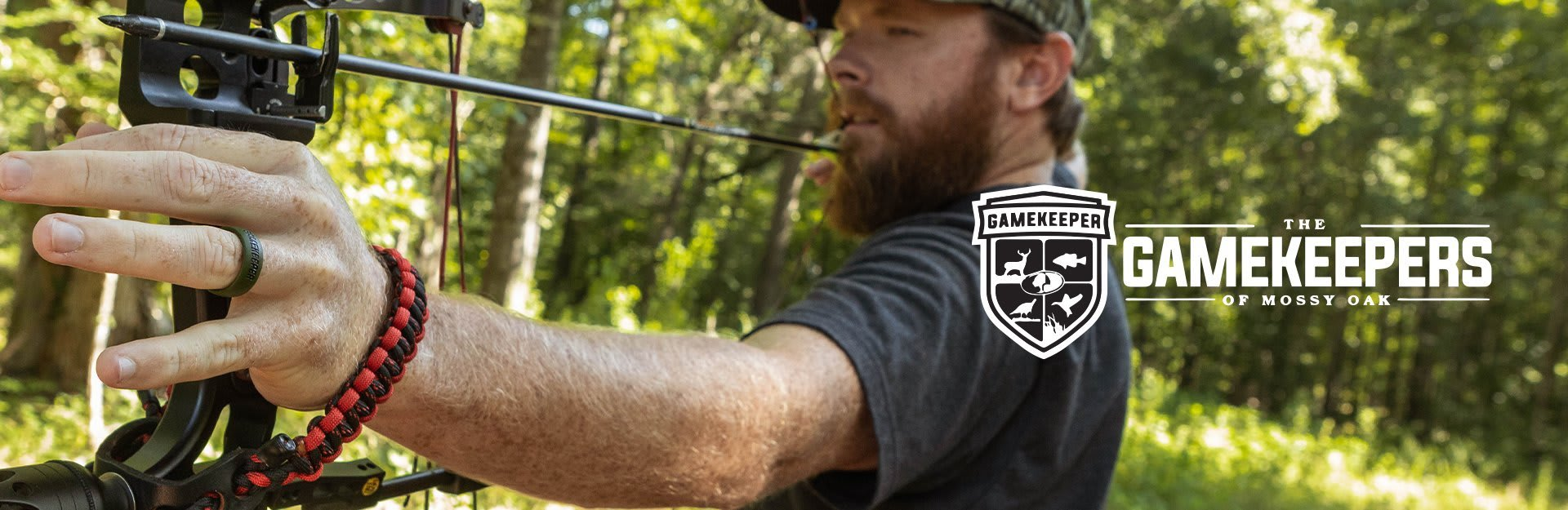 Mossy Oak Gamekeepers, a man draws his bow before shooting