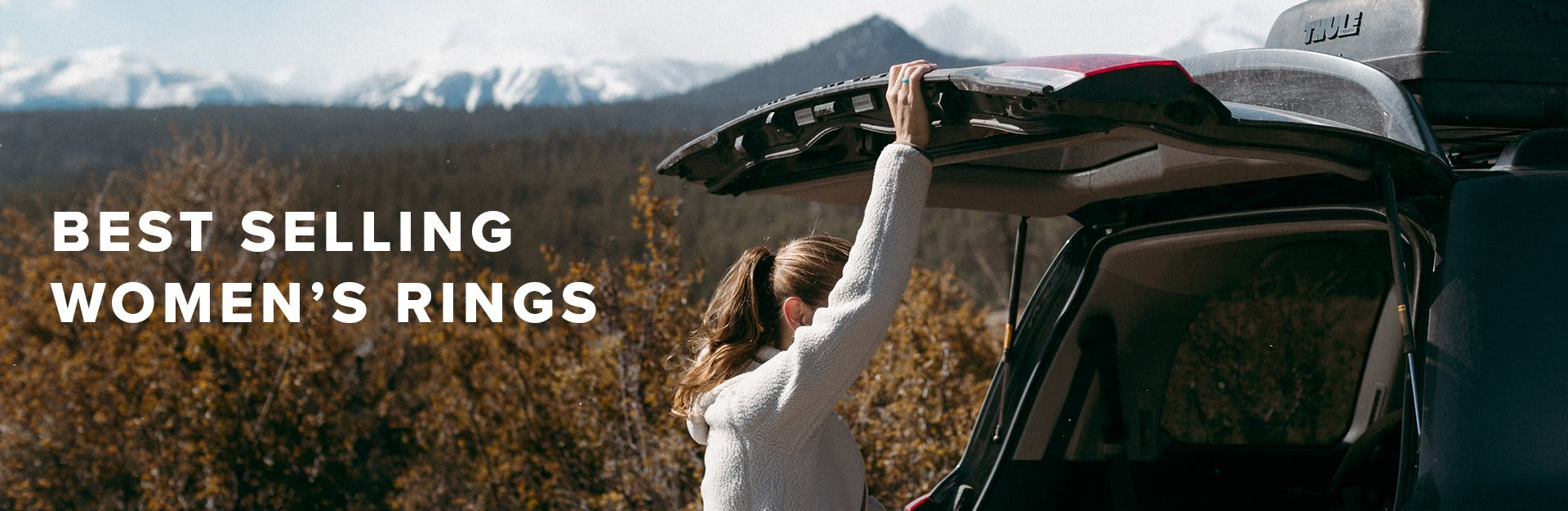 Best Selling Women's Rings, women holding the hatch of her car up with mountains in the background