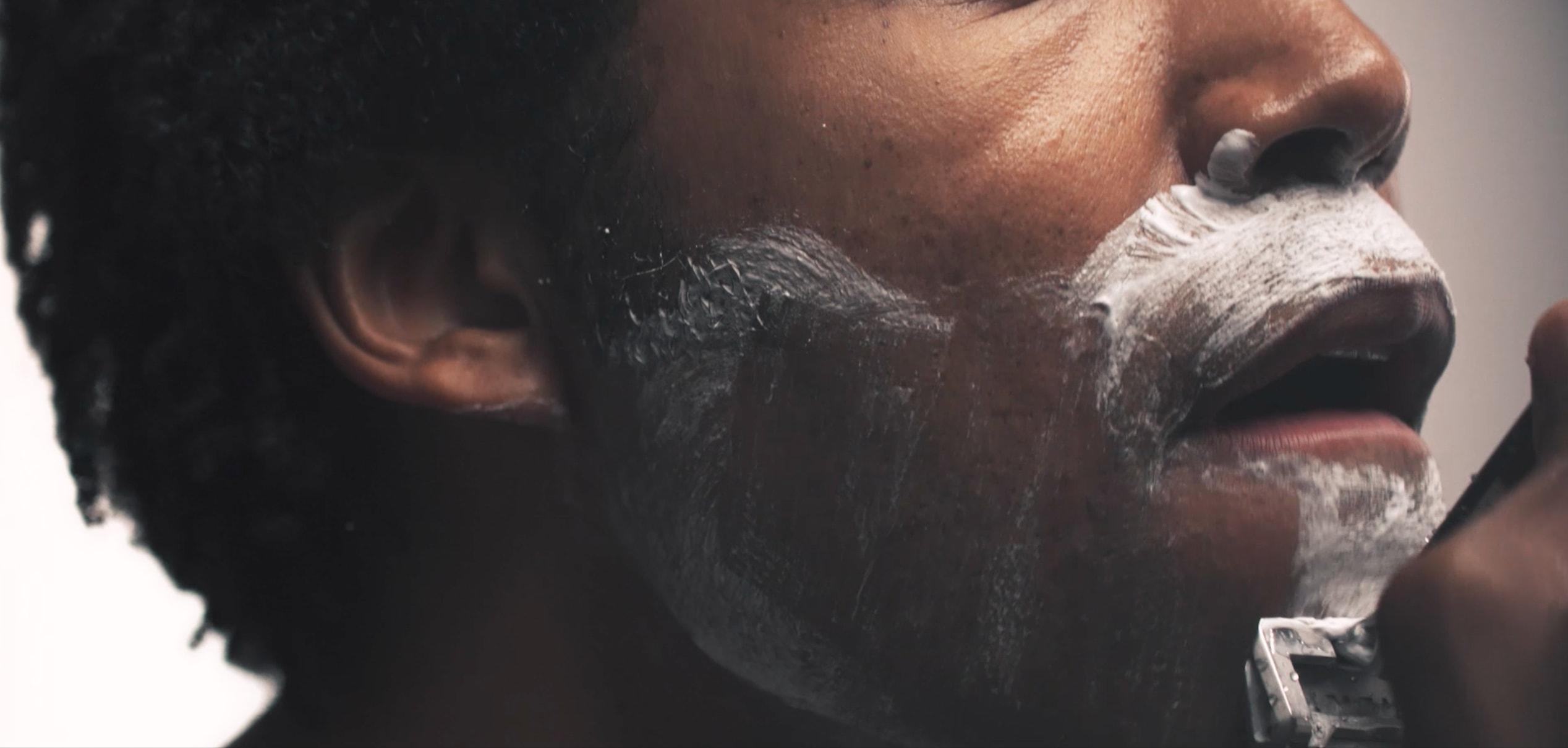 Closeup of a man shaving his chin