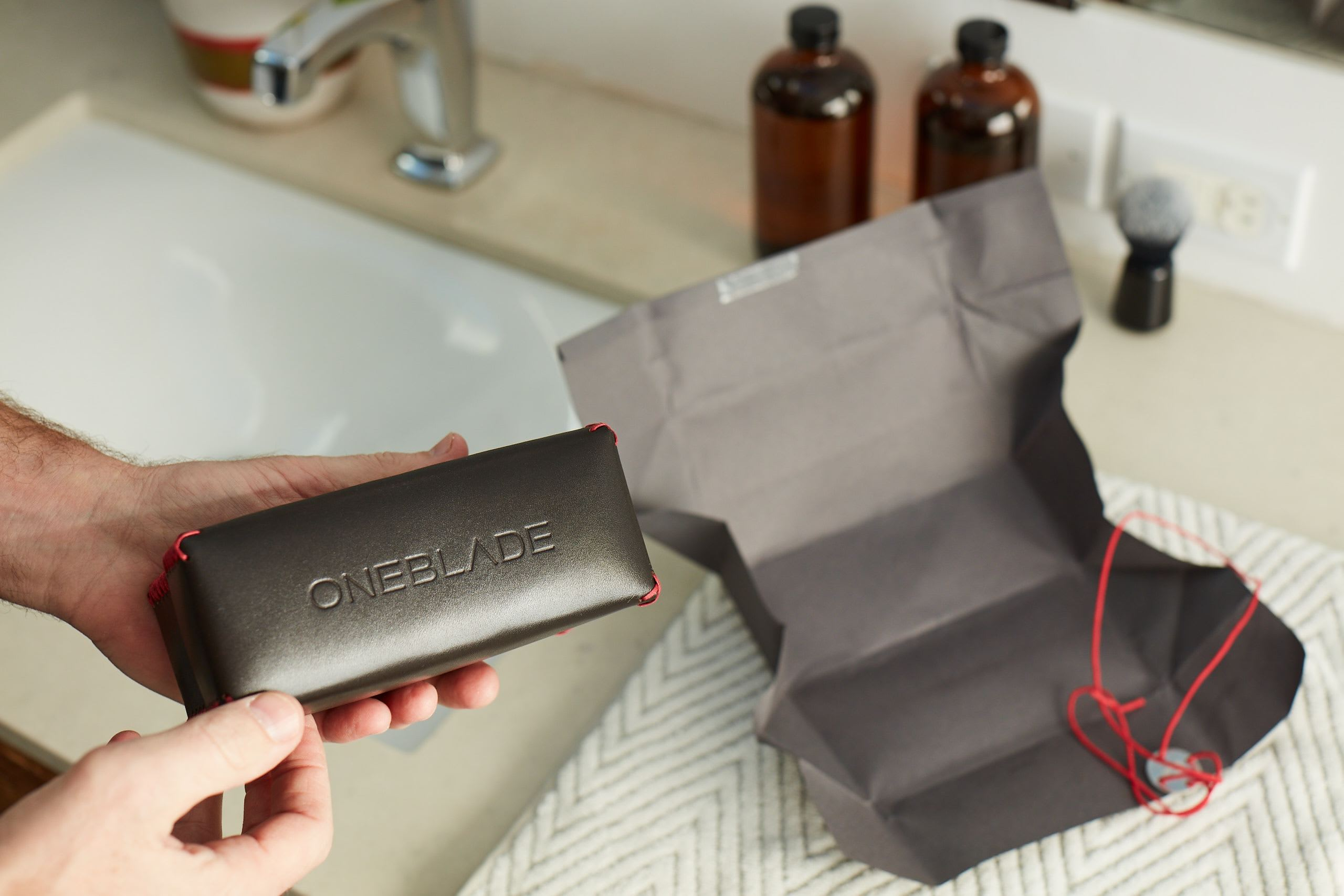 Hands holding a OneBlade case