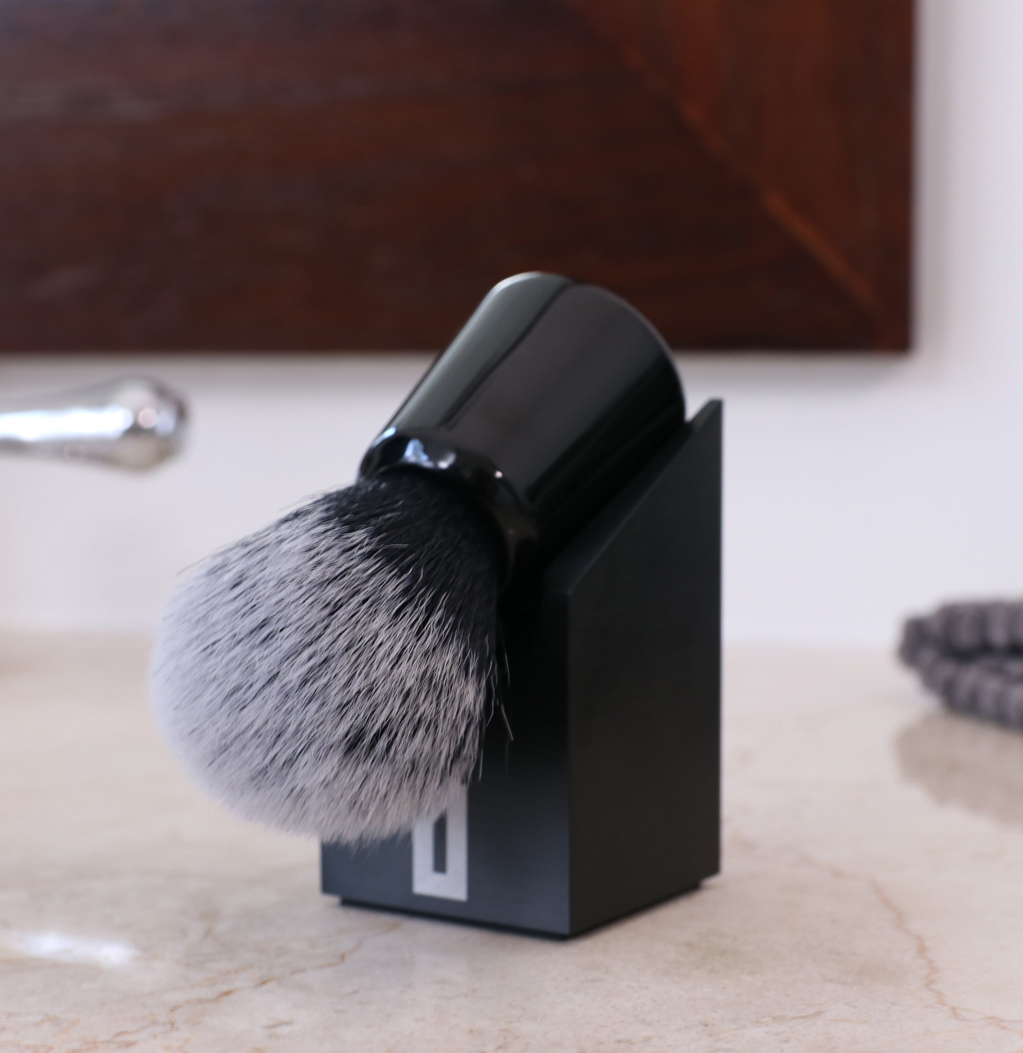 OneBlade Brush Stand with shaving brush on it