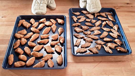 Daring plant based vegan chicken pieces on a baking sheet