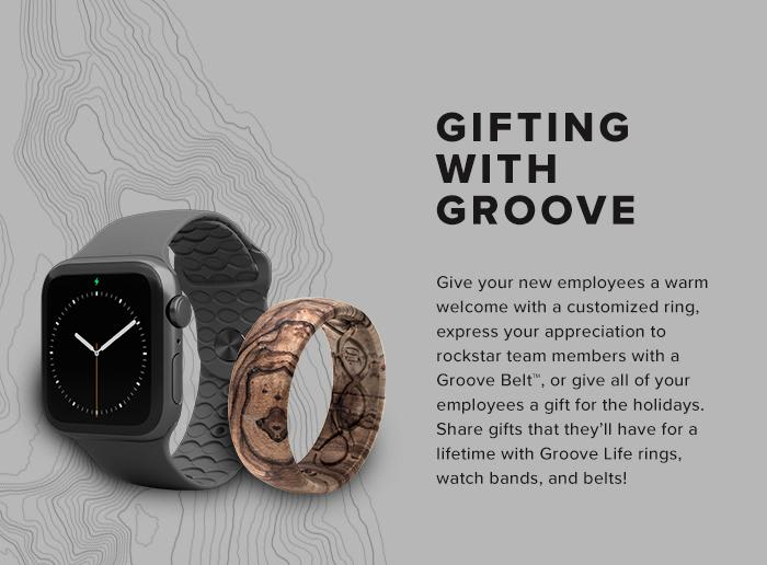 Corporate Gifting, give your new employees a customized ring  or other groove products; grey watch band beside walnut ring
