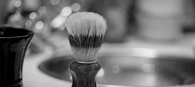 Black and white photo of a shaving brush