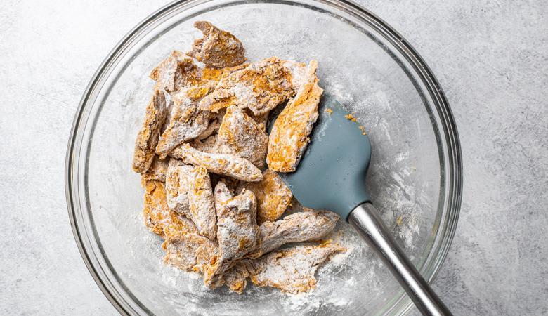 daring plant based chicken cajun pieces in a flour mixture