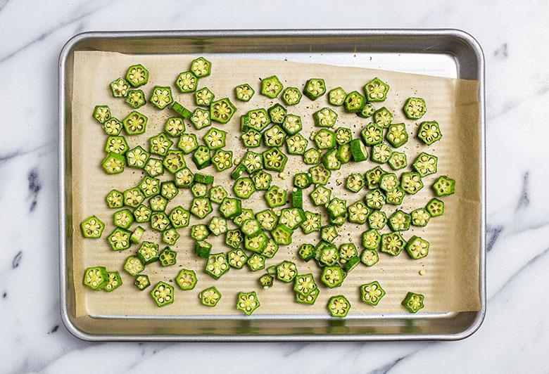 sliced okra on sheet pan