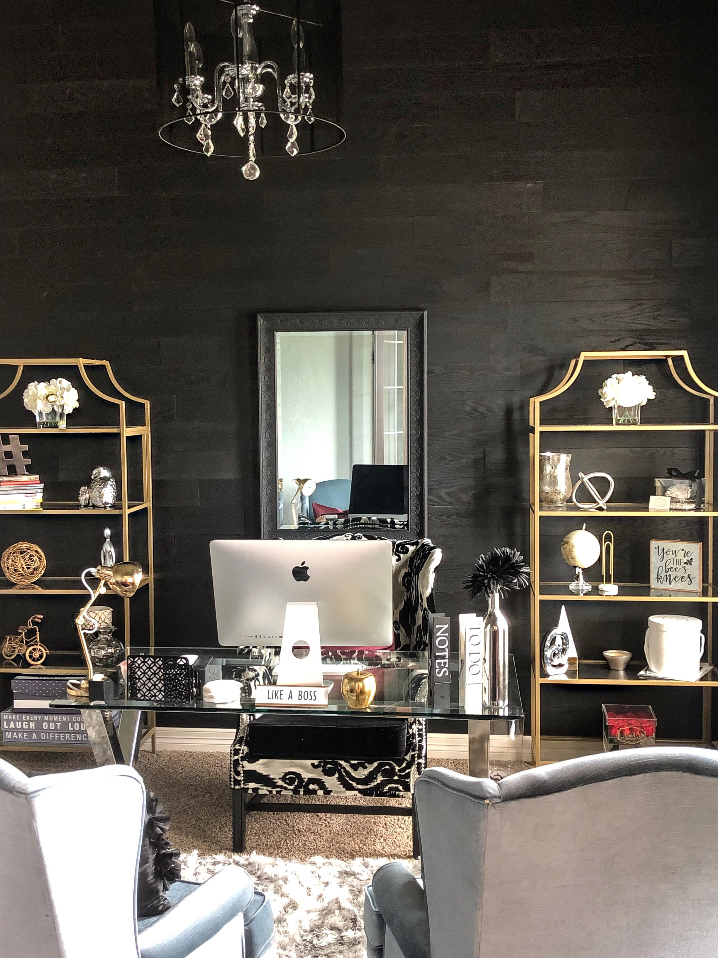 Eclectic office design with desk and a dark wood Charcoal Stikwood peel and stick wood plank feature wall.