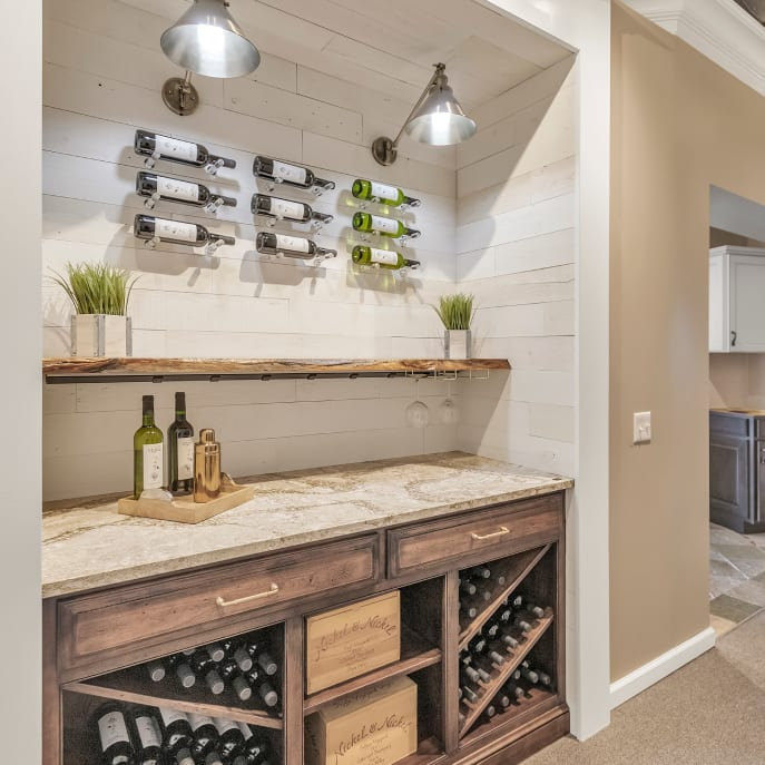 Kitchen showroom with counter inset and wine rack featuring a peel and stick shiplap accent wall form Stikwood.