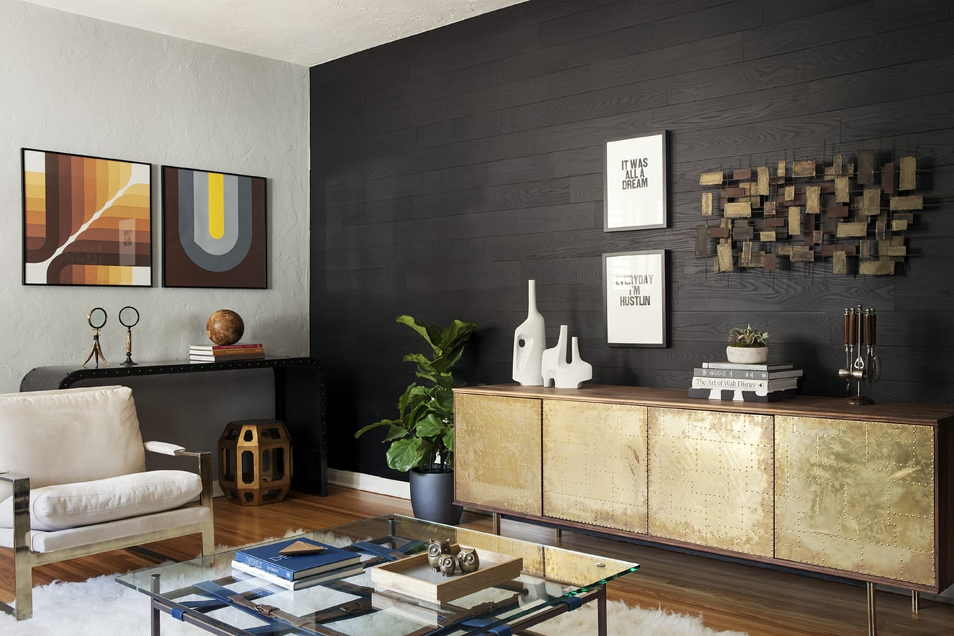 Dark wood accent wall in a midcentury modern living room created with peel and stick wood planks.